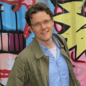 Dean van Dijk in Rotterdam with a graffiti background